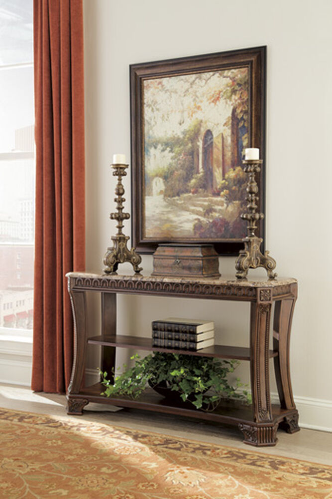 Carved legs traditional sofa table in brown mathis for Traditional sofas with legs