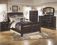 Ashley Ridgley Dark Brown Three Drawer Nightstand