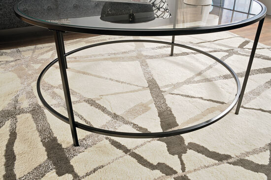 Round Contemporary Coffee Table In Black Mathis Brothers Furniture