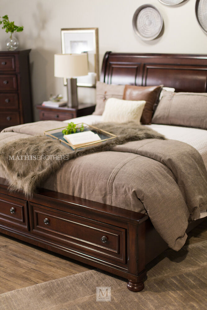 Four Piece Traditional Storage Bedroom Set In Dark Brown Mathis Brothers Furniture