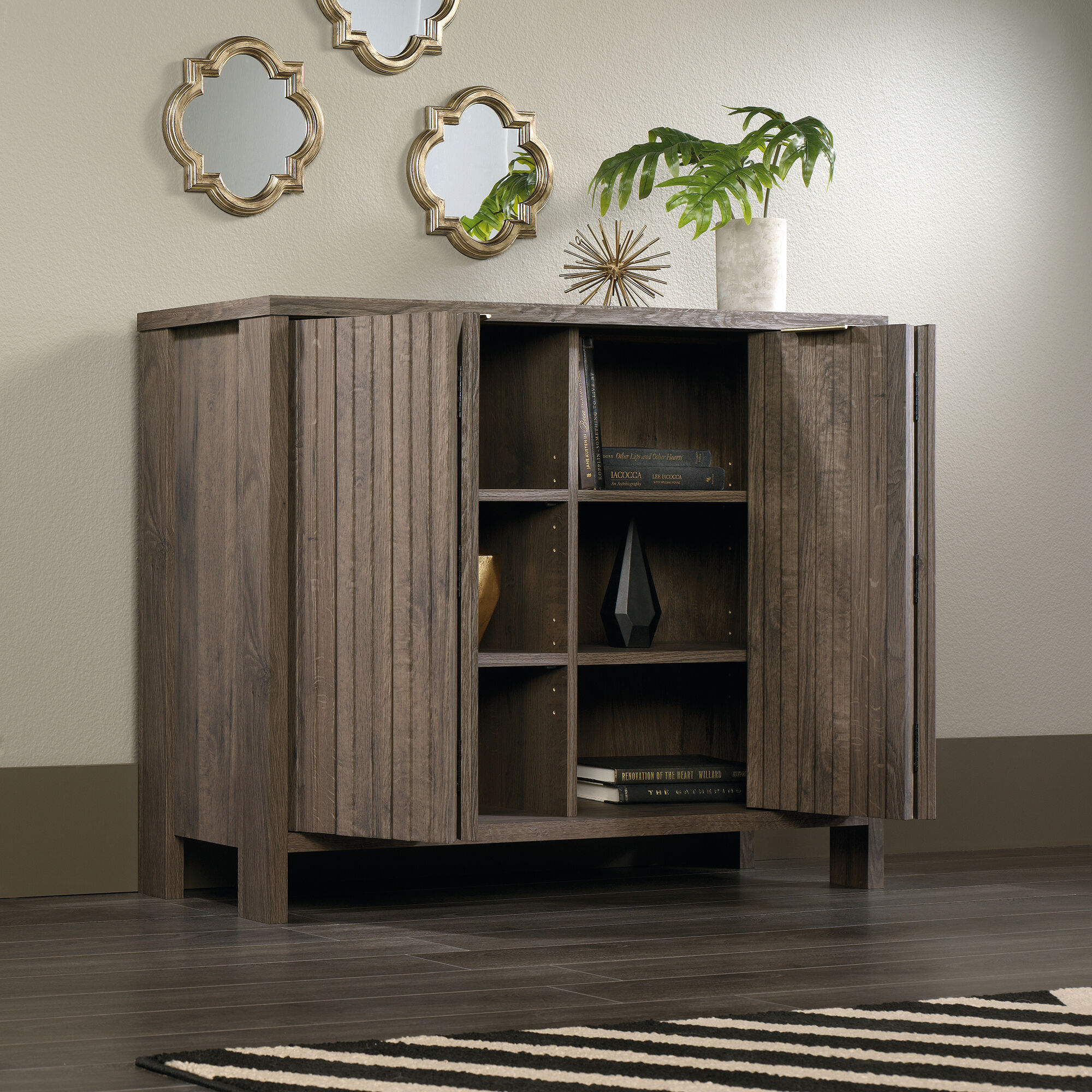 Bi fold doors contemporary storage cabinet in fossil oak mathis brothers furniture