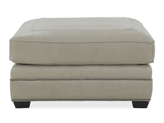 Nailhead Accented Transitional Leather Ottoman in Beige