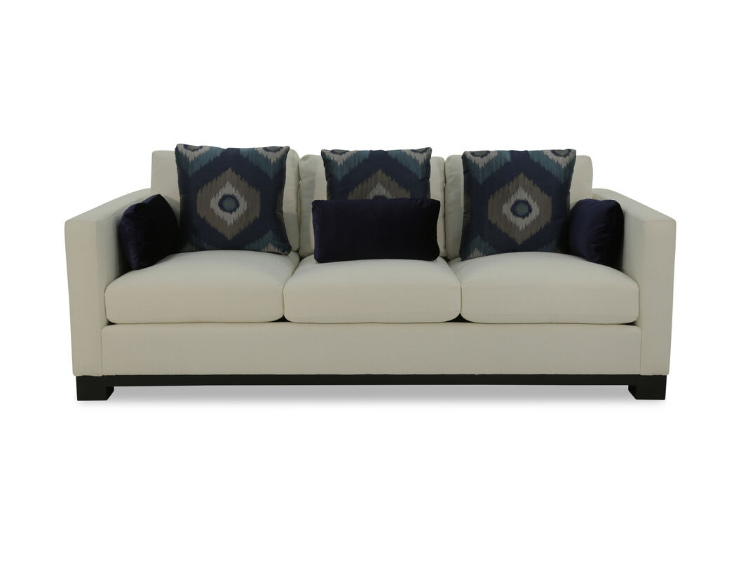Bold Block Legs Complement The Sophisticated Eal Of This Cushioned Fabric Sofa