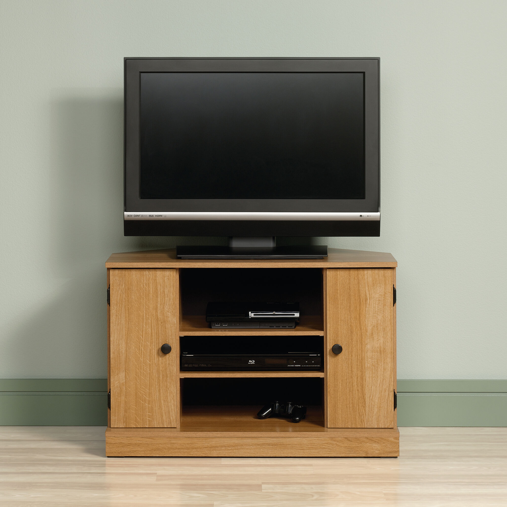 Two Cabin Door Casual Corner Tv Stand In Light Oak Mathis Brothers