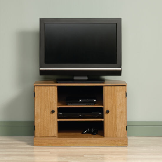 Two Cabin Door Casual Corner Tv Stand In Light Oak Mathis Brothers Furniture