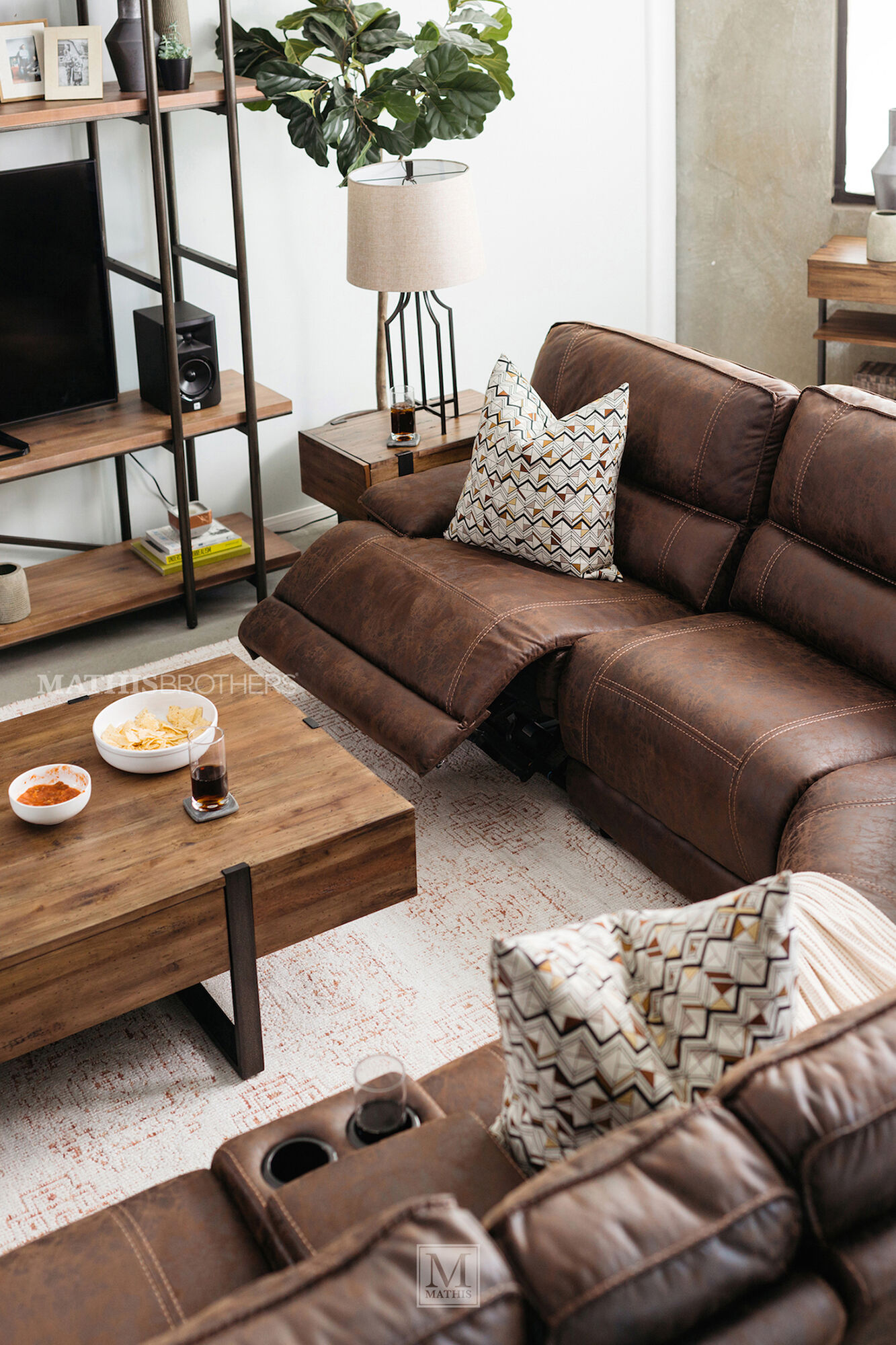Six piece traditional reclining sectional in cognac