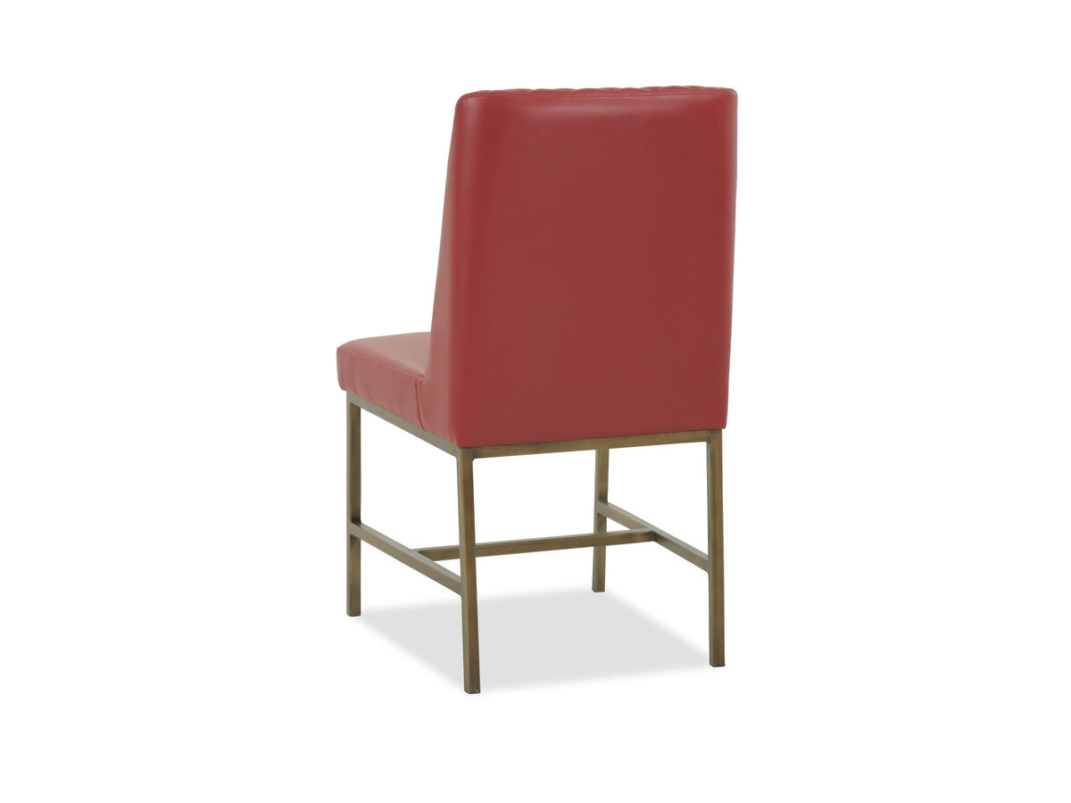 Quilted back adds textural charm to this armless chair supported on a durable metal base this casual style chair displays a dazzling red tone that gives a