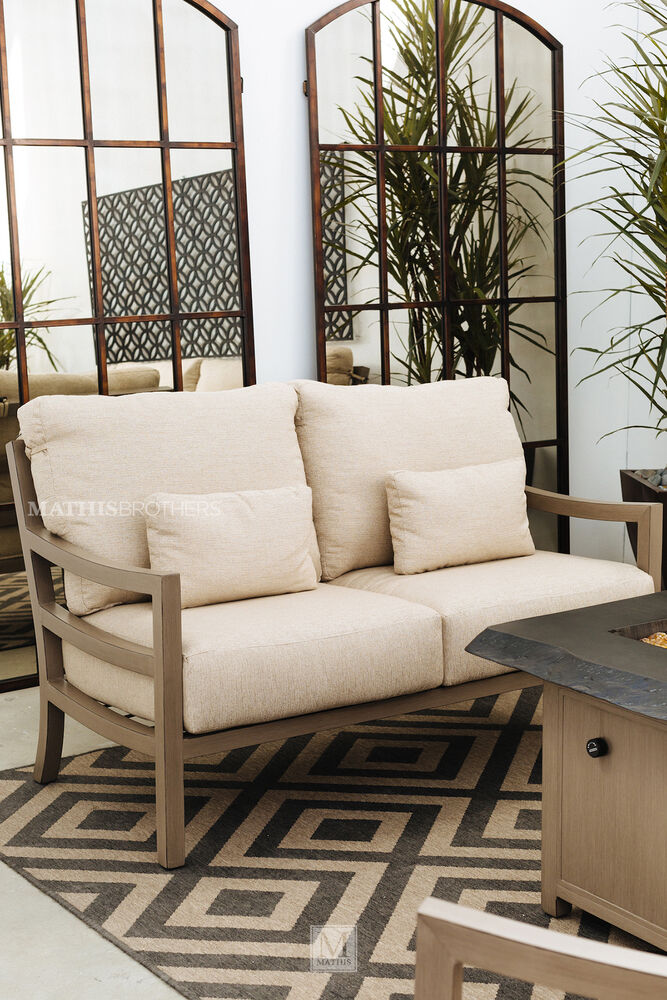 Casual patio loveseat with cushion in beige mathis brothers furniture Patio loveseat cushion
