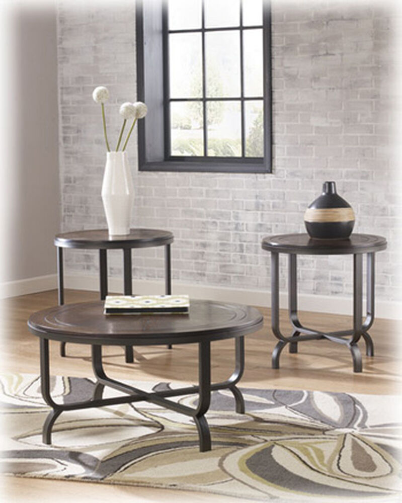 Three piece round contemporary table set in dark brown mathis brothers furniture for Round living room table sets