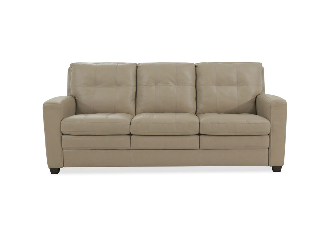 Covered In A Thick Beige Leather It S Very Good Look Quality Sofa Sitting On Dark Tapered Feet