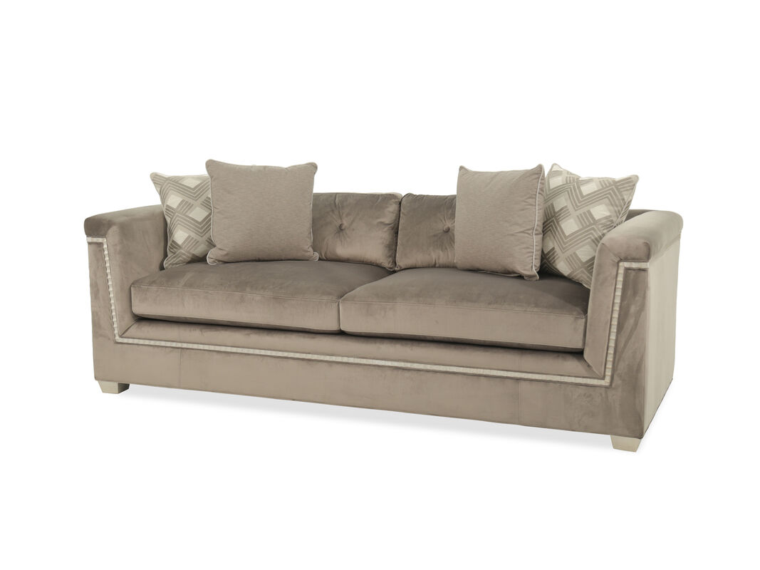 It Is Bejeweled With A Scallop Carved Wood Trim That Contrasts The Sy Tapered Feet This Sofa Accentuated Four Toss Pillows For Added Style