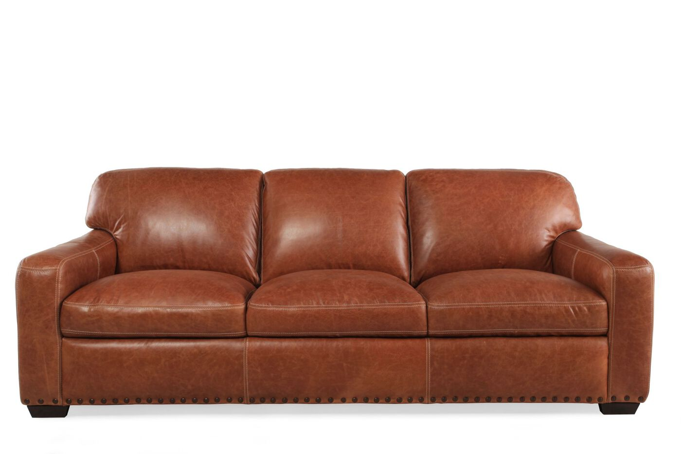 nailhead accented leather 91 sofa in saddle mathis brothers furniture. Black Bedroom Furniture Sets. Home Design Ideas