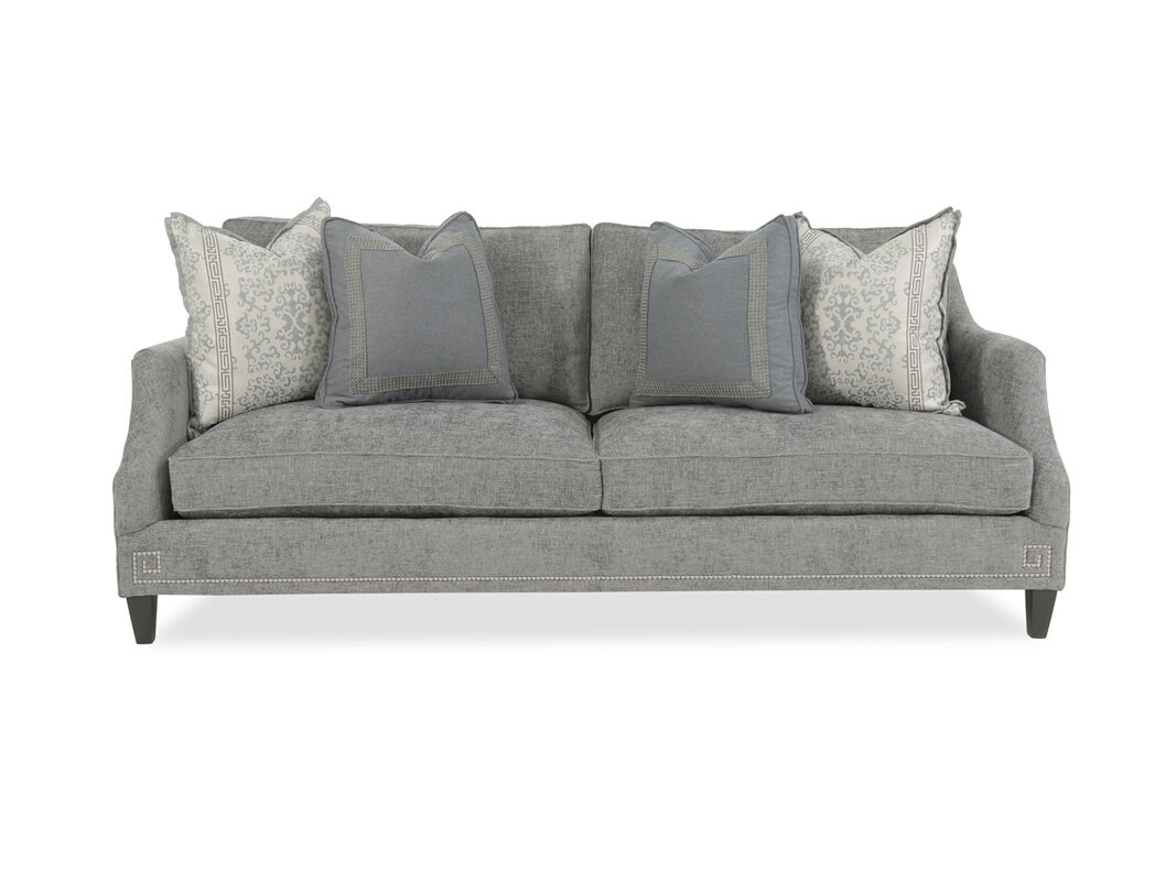 The Eye Catching Duo Of Dark Tapered Legs And Chic Nail Heads In Bright Nickel Finish Steal All Attention From Other Décor Making This Cozy Sofa A