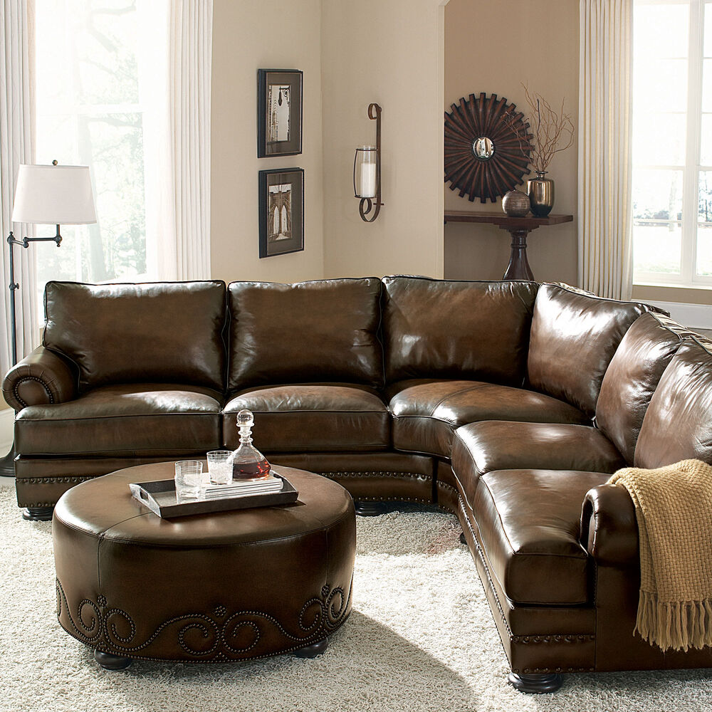 European classic nailhead accented leather 103 sectional in brown mathis brothers furniture Bernhardt living room furniture