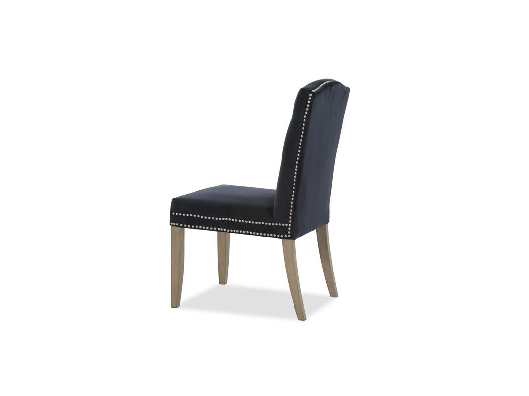 Boasting Soft Fabric Upholstery This Armless Dining Chair Offers Cushioned Support While The Tufted Back And Shiny Nail Head Accents Grace Seat