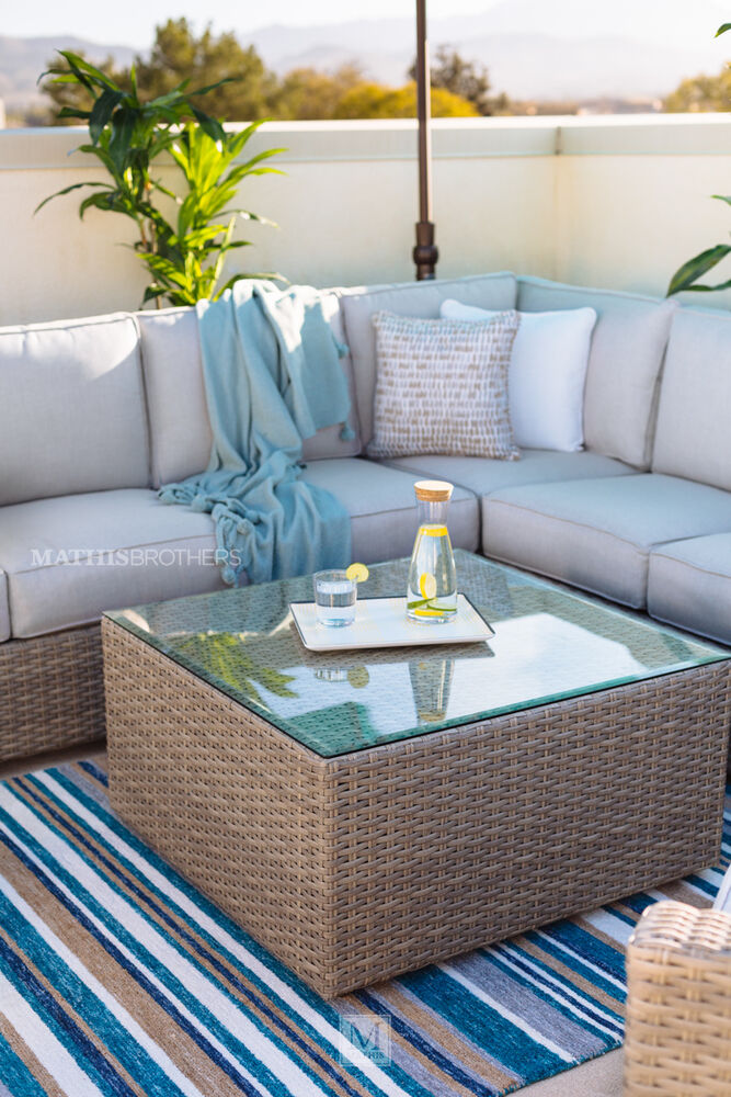 Contemporary Woven Patio Glass Top Coffee Table In Light Grey Mathis Brothers Furniture